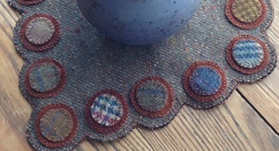 Penny rug table mat with vase upclose