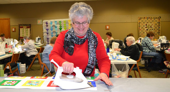 Ironing blocks at Quilters Retreat