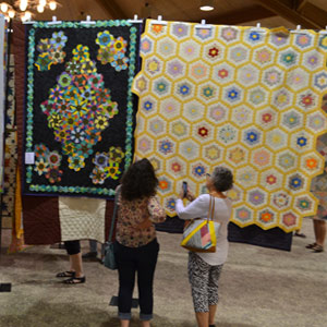 people looking at quilts