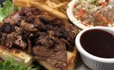 Beef-Brisket-on-bread-coleslaw-BBQ-sauce-side