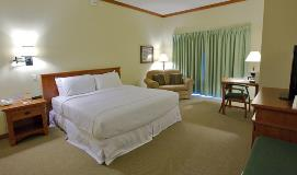 King-size bed room accommodations available for booking at Sauder Heritage Inn